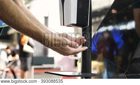 Close Up Of Washing Hands With An Automatic Alcohol Sanitizer Dispenser. Media. Hand Sprayed By Cont