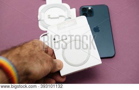 Paris, France - Nov 2, 2020: Pov Holding Unboxing Testing Of New Magsafe By Apple Computers A Propri