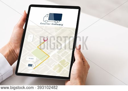 Courier Delivery Check, Gps Navigation And Online Shopping. Woman Using Tablet With Map App On Scree