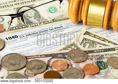 Closeup Image Of American 1040 Individual Income Tax Return Form With American Dollar Money, Coins,
