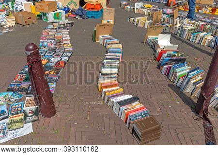 Amsterdam, Netherlands - May 16, 2018: Old Books Laying At Street Flea Market In Amsterdam, Holland.