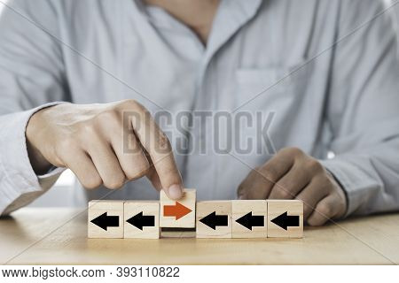 Disruption  And Different Thinking Concept , Businessman Holding Red Arrow Among Black Arrow Which P