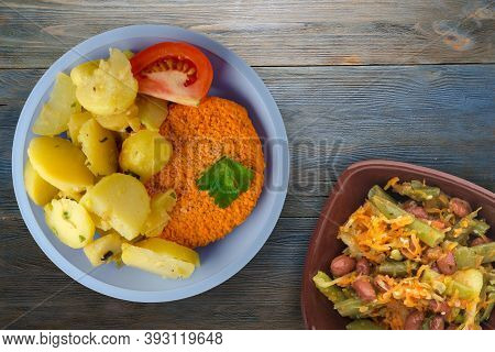 Meatball With Potatoes On Grey Blue Wooden Background. Meatball With A Slice Of Tomato On Light Blue