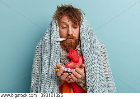 Photo Of Sick Ginger Man Feels Sick, Has Winter Flu Virus, Suffers From Fever And High Temperature,