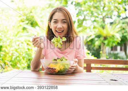 The Happy Beautiful Asian Healthy Middle Aged Woman Sitting In The Balcony Of The House Beside The G