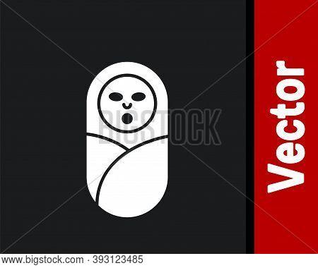 White Newborn Baby Infant Swaddled Or Swaddling Icon Isolated On Black Background. Baby Kid Child Wr