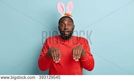 Dark Skinned Man Imitates Scared Fearfulrabbit, Mimics, Dressed In Red Jumper, Fluffy Bunny Ears, Ha