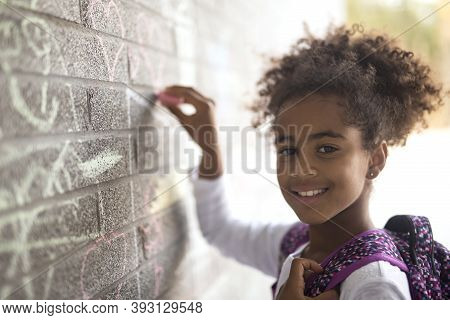 Cheerful African American Primary School Girl With Backpack