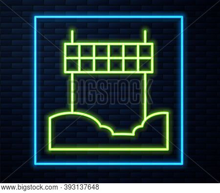 Glowing Neon Line Ribbon In Finishing Line Icon Isolated On Brick Wall Background. Symbol Of Finish