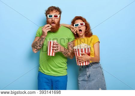 Bearded Red Haired Man Watches Favourite Genre Of Film, Eats Popcorn From Bucket, Visits Cinema With