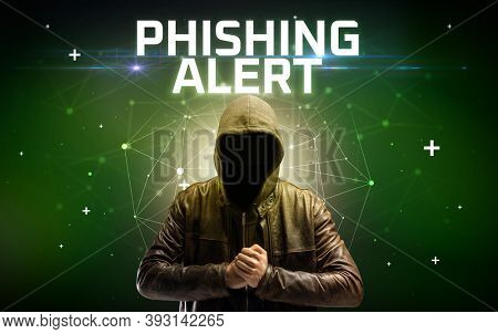 Mysterious hacker with PHISHING ALERT inscription, online attack concept inscription, online security concept
