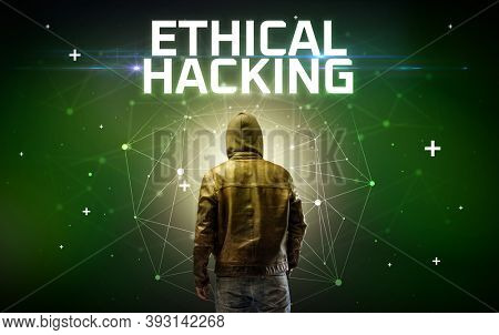 Mysterious hacker with ETHICAL HACKING inscription, online attack concept inscription, online security concept