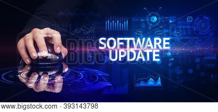 hand holding wireless peripheral with SOFTWARE UPDATE inscription, modern technology concept