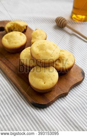Homemade Cornbread Muffins On A Rustic Wooden Board, Side View.