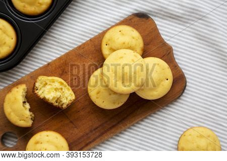 Homemade Cornbread Muffins On A Rustic Wooden Board, Top View. Flat Lay, From Above, Overhead.