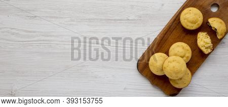 Homemade Cornbread Muffins On A Rustic Wooden Board On A White Wooden Background, Top View. Flat Lay