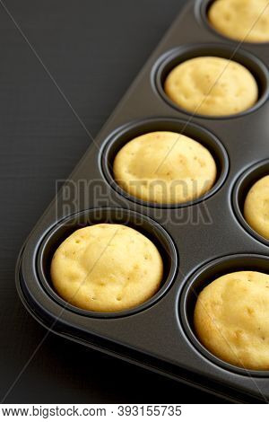 Homemade Cornbread Muffins On A Black Surface, Low Angle View. Copy Space.