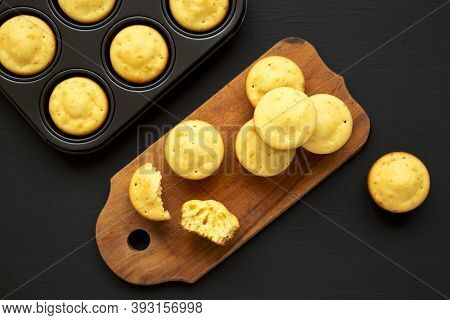 Homemade Cornbread Muffins On A Rustic Wooden Board On A Black Surface, Top View. Flat Lay, Overhead
