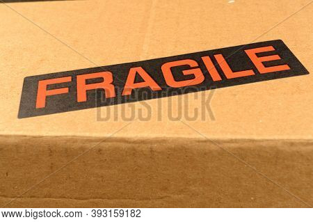 A Closeup View Of A Fragile Shipping Label On A Box Exterior.