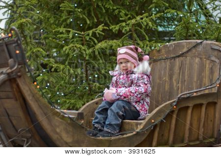 Little Girl On Sleigh