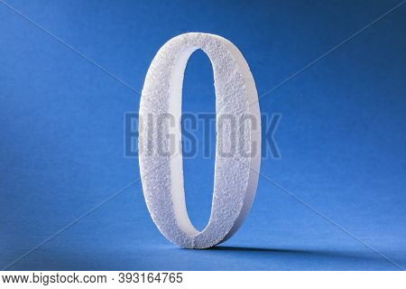 The Digit Is Zero Made Of Foam On A Blue Background. Concept On Zeroing