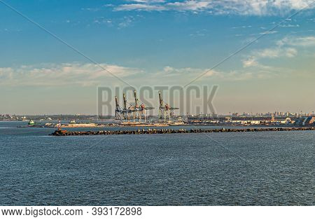 Montevideo, Uruguay- December 18, 2008: Cranes At Shipping Container Terminal In Port Behind Protect