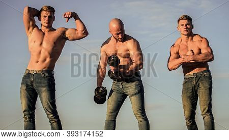 Body Uses Protein To Build New Muscle. Strong Men Blue Sky Background. Group Muscular Men. Athletic