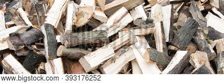 Banner. Heap Of Chopped Firewood Background. Pile Of Split Firewood. Stack Of Fuel Wood