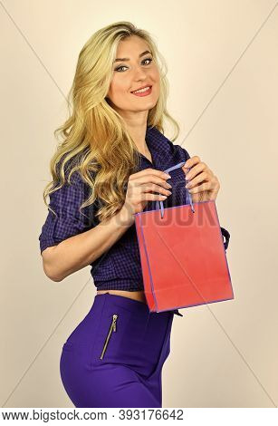 Shopping Happiness. Sexy Blonde Carry Shopping Bags. Elegant Woman Shopaholic. Shopper Hold Paperbag