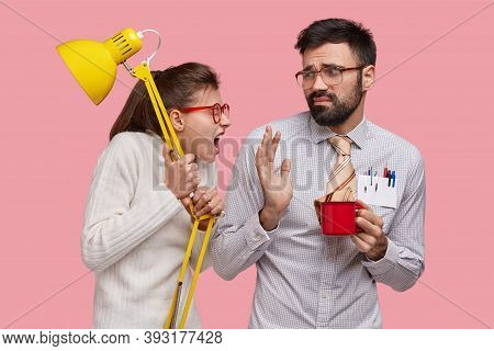 Ouraged Pissed Woman Holds Yellow Lamp Shouts At Lazy Groupmate, Demands To Help, Wears Spectacles.