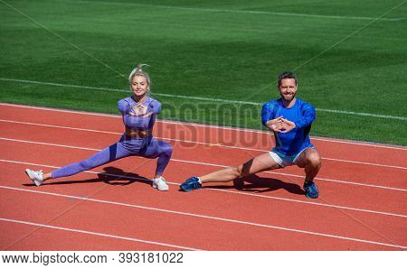 Man And Woman Sport Trainer. Fitness Couple Training Outdoor. Stretch Exercising And Warm Up. Workou