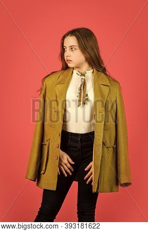 Oversize Concept. Trench Coat Fashion Trend. Fashionable Coat. Little Girl Posing Jacket Coat With C