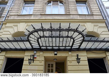 Retro Style Ironwork And Glass Structure At Building Exterior