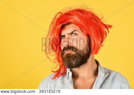 Serious Man In Color Wig. Serious Bearded Man Looking At Camera. Portrait Of Serious Man. Isolated.