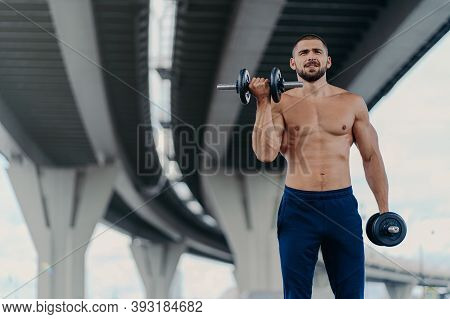 Self Confident Bearded Man Exercises With Barbells Outdoor Has Naked Torso Muscular Shirtless Body T