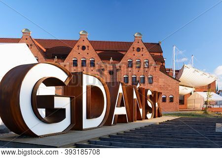 Gdansk, Poland - June 26, 2018: Gdansk City Sign In The Old Town Of The City On The Background Of Ba