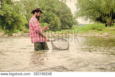 Gone Fishing. Bearded Fisher In Water. Hobby And Sport Activity. Pothunter. Summer Weekend. Big Game