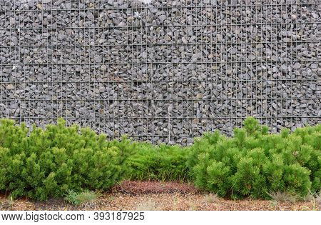 Gabion Stone Fence. Elements Of Angular Rock And Wire Mesh Gabions.