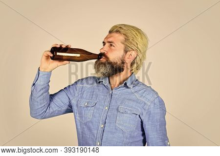 Refreshing Lemonade. Soda Drink. Hipster At Bar. Man Beard And Mustache Hold Bottle. Alcohol Drink.