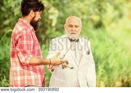Help Concept. Mature Man Fisher Celebrate Retirement. Summer Family Weekend. Father And Son Fishing.