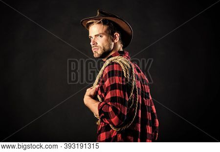 Western Life. Man Wearing Hat Hold Rope. Lasso Tool Of American Cowboy. Lasso Is Used In Rodeos As P