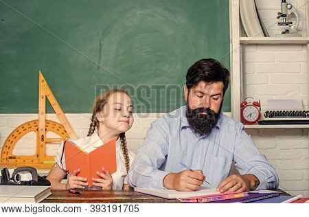 Lesson Is Finished. Man Bearded Pedagogue Study Together With Kid. Study Is Fun. School Teacher And