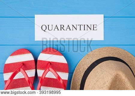 Summer Vacation And Quarantine Concept. Top Above Overhead View Photo Of Word Quarantine Flipflops A