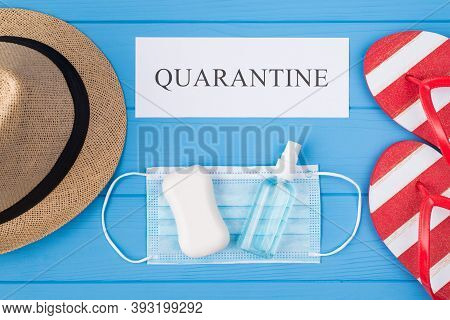 Quarantine And Summertime Fun Concept. Top Above Overhead View Photo Of Soap Sanitizer Mask Flipflop