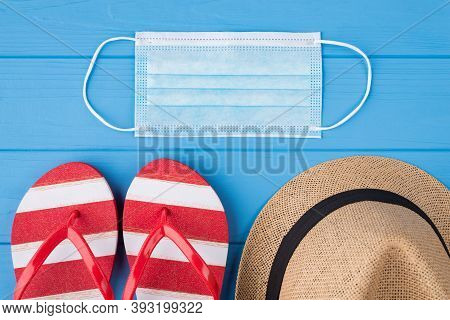 Covid Protection And Vacation Concept. Top Above Overhead View Photo Of Face Mask Flipflops And Hat