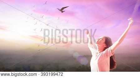 Freedom Concept: Beautiful Girl Over Sky And Birds Flying Sunset Background
