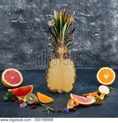 Sliced Pineapple And Citrus Fruit Slices, Sliced Citrus Fruits Pineapple Over Dark Background. Healt