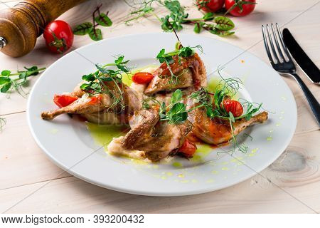 Roasted Or Fried Whole Quails With Herbs On Wooden Table, Fried Partridge At A White Plate