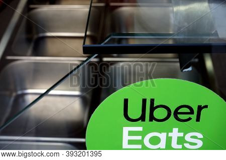 Bucharest, Romania - October 11, 2020: An Uber Eats Food Delivery Sticker Is Seen On The Window Of A