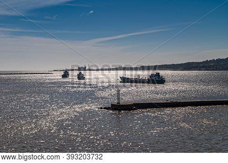 Montevideo, Uruguay- December 18, 2008: Twilight Sunshine Reflected By Rio De La Plata Water With Tr